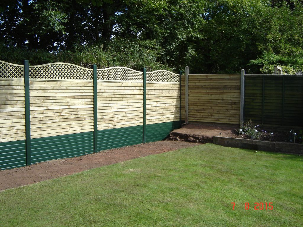 light wooden garden fence with green edge